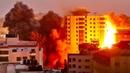 Военные Израиля запустили четыре ракеты и уничтожили высотку в секторе Газа