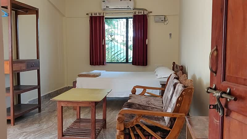 Morjim Sunset Guesthouse - Hotel room with private kitchen