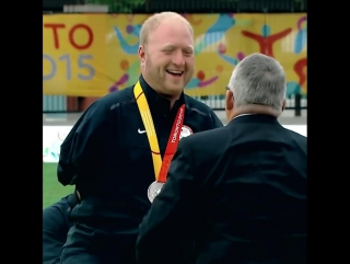 When you're giving out medals but try to shake the hand of an armless man