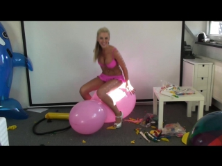 Stella blow up and bounce on big pink doll balloon to pop