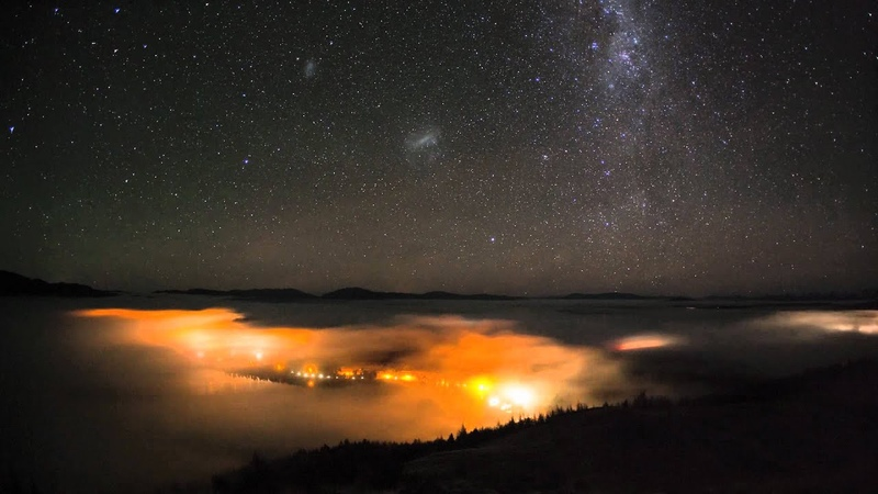 Tekapo Village lights mixed with Fog and the Southern Night Sky