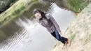 Wetlook. Girl jump in water full clothed. Leather jacket and wet jeans.