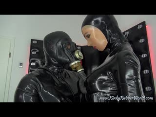 Black catsuit and gas mask