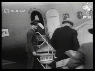 American journalist H.R. Ekins makes flight trip around the world (1936)