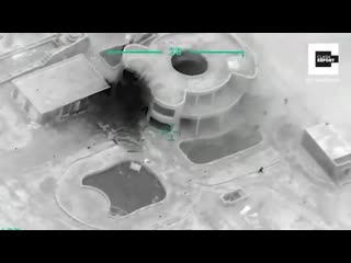 Ammunition trucks belonging to the Regime hiding under a building approximately 20 km nort